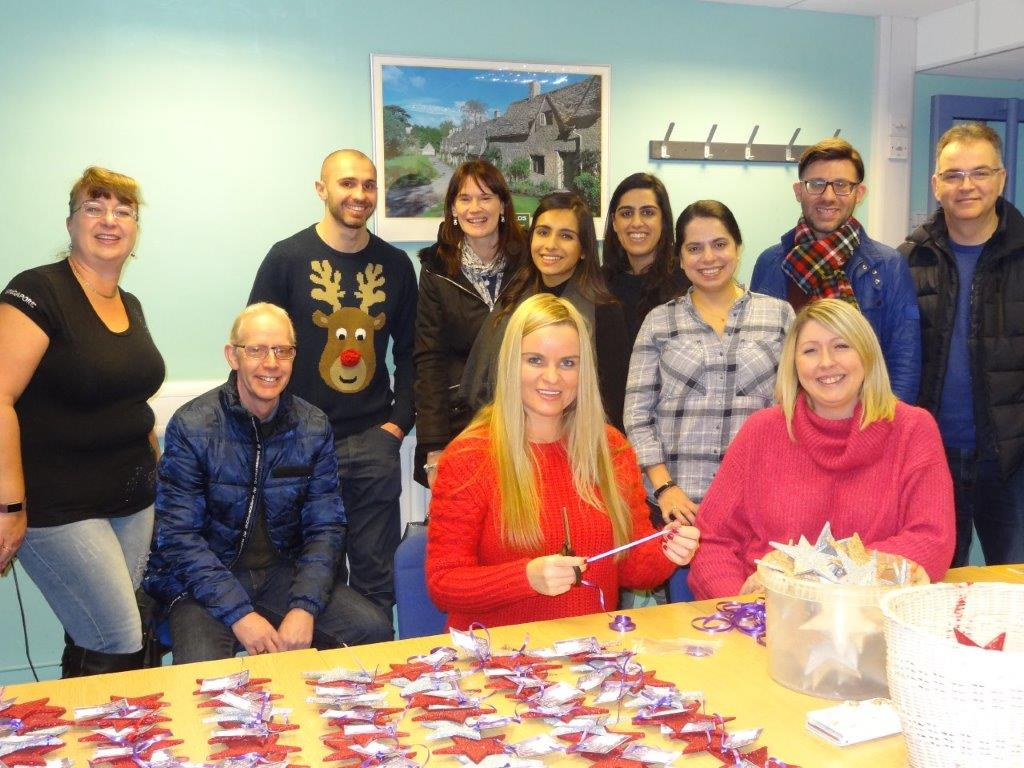 Christmas helpers at the Cotswold Friends offices!